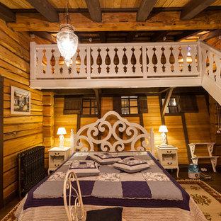 Inspiration för ett rustikt sovrum