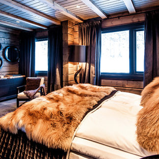 Inspiration for a large rustic guest bedroom remodel in Moscow with brown walls