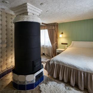 Diseño de dormitorio principal, campestre, pequeño, con paredes verdes y estufa de leña