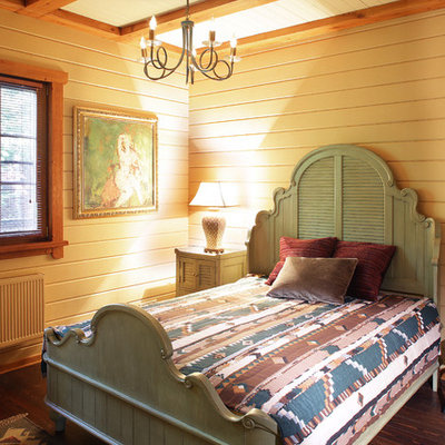 Example of a mid-sized country guest dark wood floor and brown floor bedroom design in Moscow with beige walls