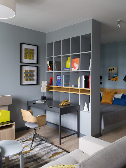 compact bedroom design. Example of a small trendy master light wood floor bedroom design in Moscow  with gray walls Our 50 Best Small Bedroom Ideas Decoration Pictures Houzz