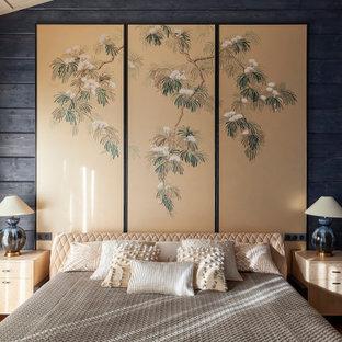 Rustikales Gästezimmer mit blauer Wandfarbe, Holzdielendecke, Holzwänden und braunem Boden in Moskau