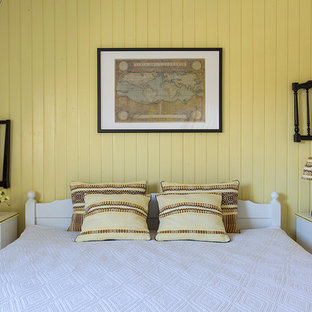 Inspiration for a country bedroom in Moscow with yellow walls.