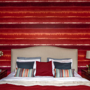 Inspiration for a mid-sized eclectic master bedroom remodel in Other with red walls