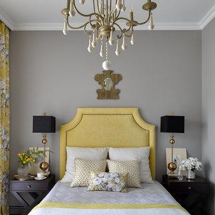 Idée de décoration pour une petit chambre d'amis tradition avec un mur gris.