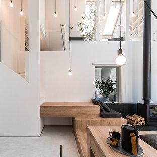 На фото: хозяйская спальня в современном стиле с белыми стенами, печью-буржуйкой и фасадом камина из металла