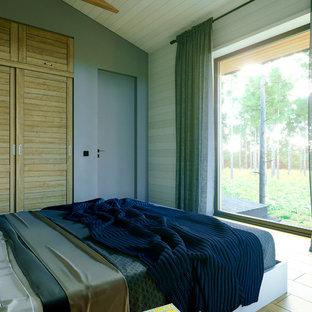 Ejemplo de dormitorio principal, nórdico, de tamaño medio, con paredes azules, suelo de baldosas de porcelana y suelo amarillo