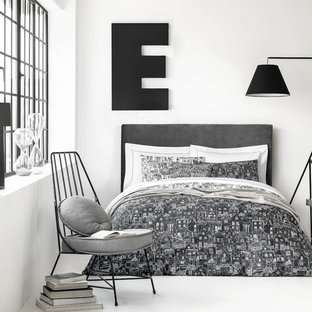 Inspiration for a scandinavian bedroom in Moscow with white walls and white floors.