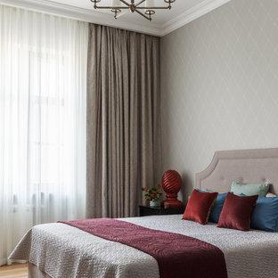 На фото: спальня в стиле современная классика с серыми стенами, паркетным полом среднего тона и коричневым полом с