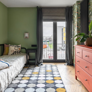 Photo of a large contemporary guest bedroom in Other with green walls, medium hardwood floors, brown floor and wallpaper.