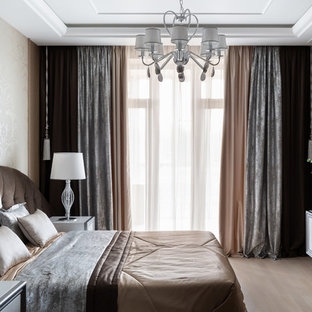 Large eclectic master light wood floor and beige floor bedroom photo in Saint Petersburg with a hanging fireplace