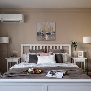 На фото: хозяйская спальня в стиле современная классика с бежевыми стенами, паркетным полом среднего тона и коричневым полом