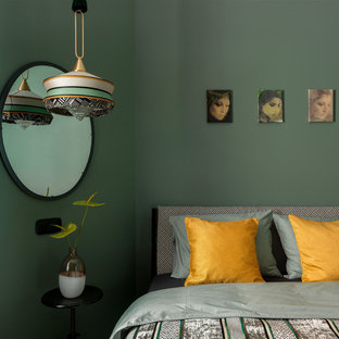 Photo of a small eclectic master bedroom in Moscow with green walls, medium hardwood floors and brown floor.