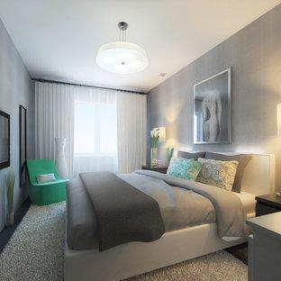 Exempel på ett mellanstort modernt huvudsovrum, med grå väggar, laminatgolv och svart golv