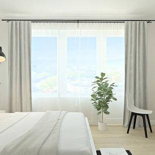 他の地域の中サイズの北欧スタイルのおしゃれな主寝室 (白い壁、ラミネートの床、ベージュの床) のインテリア