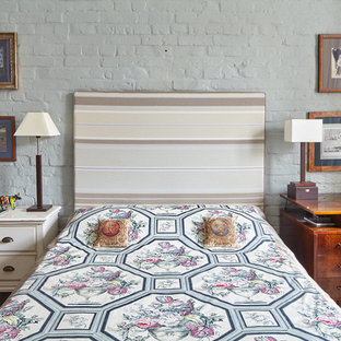 Example of a mid-sized eclectic master linoleum floor bedroom design in Moscow with white walls and no fireplace