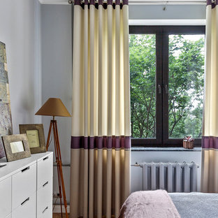 Design ideas for a small master bedroom in Moscow with grey walls, medium hardwood flooring and yellow floors.