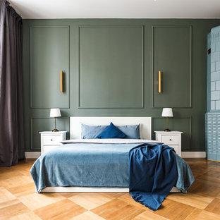 На фото: спальня в современном стиле с зелеными стенами, паркетным полом среднего тона, угловым камином, фасадом камина из плитки, коричневым полом и правильным освещением