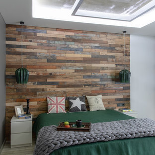 Small industrial master bedroom in Other with brown walls, porcelain floors and grey floor.