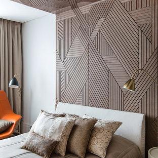 На фото: гостевые спальни в современном стиле с бежевыми стенами и ковровым покрытием