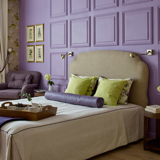 This is an example of a transitional master bedroom in Other with purple walls, medium hardwood floors and brown floor.