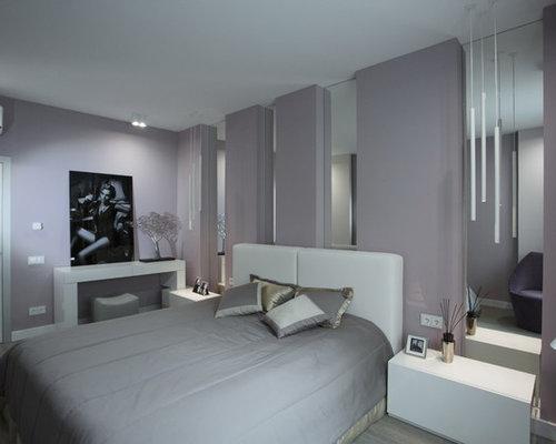 Camera da letto contemporanea con pareti rosa - Foto e Idee per Arredare