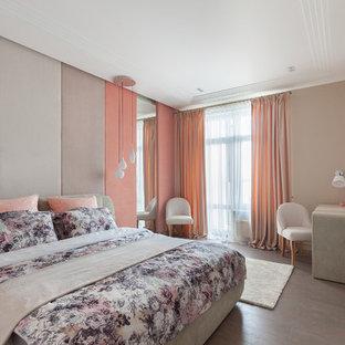 Ejemplo de dormitorio contemporáneo con suelo de corcho