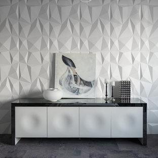 Ispirazione per una camera matrimoniale minimal con pareti grigie