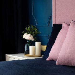 Diseño de dormitorio minimalista, de tamaño medio, con paredes azules