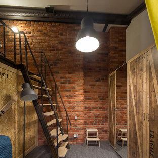 Foto de dormitorio tipo loft, industrial, con suelo de linóleo y paredes marrones