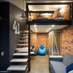 This is an example of an industrial loft-style bedroom in Saint Petersburg with linoleum floors and multi-coloured walls.