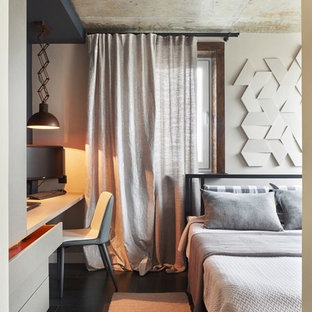 Photo of a small industrial master bedroom in Other with white walls, vinyl floors and black floor.