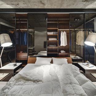 Inspiration för industriella sovrum, med beiget golv