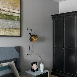 Photo of a mid-sized contemporary master bedroom in Other with grey walls, vinyl floors, no fireplace and yellow floor.