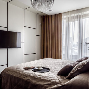 На фото: спальня в современном стиле с