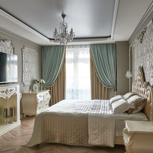 Bedroom - victorian master medium tone wood floor bedroom idea in Other with gray walls and a standard fireplace