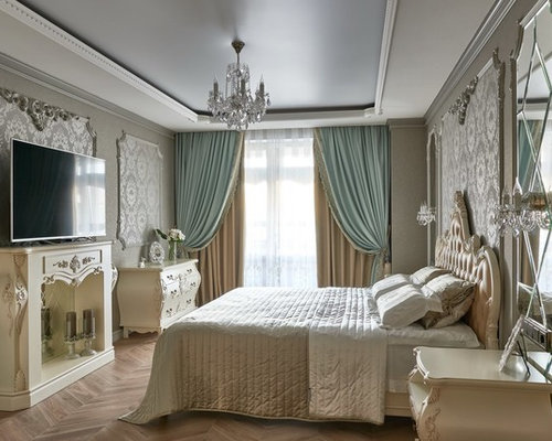 Victorian master medium tone wood floor bedroom idea in Other with gray  walls and a standard