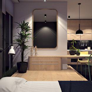 Ejemplo de dormitorio principal, contemporáneo, con paredes grises y suelo de contrachapado