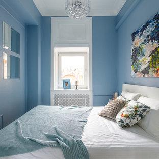 Esempio di una piccola camera degli ospiti minimal con pareti blu