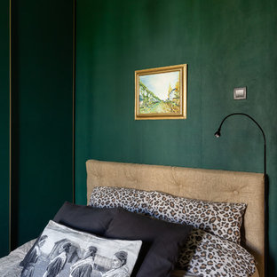 This is an example of a small eclectic master bedroom in Saint Petersburg with green walls, medium hardwood floors and no fireplace.