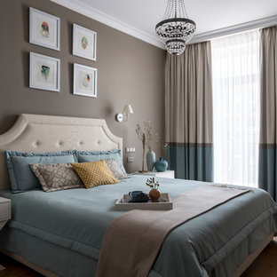 Design ideas for a transitional master bedroom in Moscow with medium hardwood floors, brown floor and grey walls.