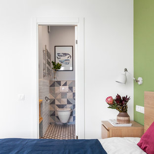Inspiration for a mid-sized scandinavian master bedroom in Moscow with green walls and medium hardwood floors.