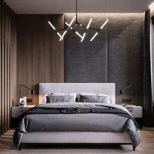 Foto de dormitorio principal, nórdico, de tamaño medio, con paredes negras, suelo de madera clara y suelo beige