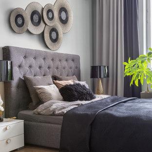 На фото: хозяйская спальня в стиле современная классика с белыми стенами, паркетным полом среднего тона и коричневым полом