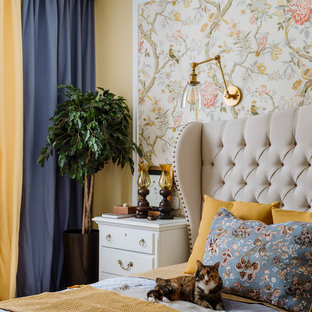 Inspiration for a mid-sized traditional master bedroom in Moscow with yellow walls, light hardwood floors and beige floor.