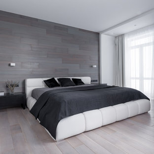 Inspiration for a contemporary master light wood floor bedroom remodel in Other with gray walls