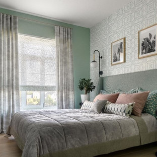 Inspiration for a mid-sized modern master bedroom in Other with green walls, medium hardwood floors and beige floor.