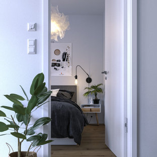 Inspiration for a small scandinavian master laminate floor and beige floor bedroom remodel in Other with white walls