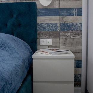 他の地域の小さいコンテンポラリースタイルのおしゃれな主寝室 (青い壁、ラミネートの床、暖炉なし、グレーの床) のレイアウト