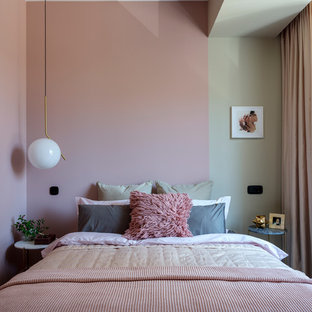 This is an example of a contemporary master bedroom in Moscow with pink walls.